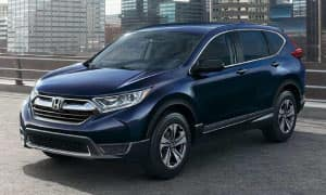 A dark blue 2019 Honda CR-V atop a parking structure in a city