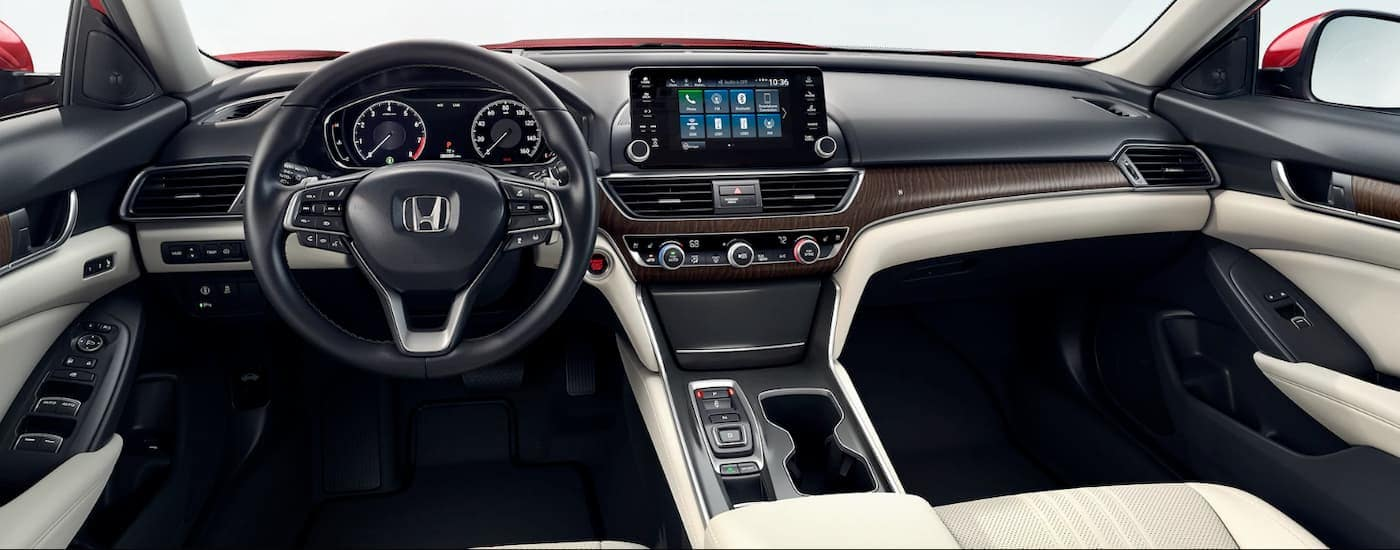 The white, black, and wood grain dashboard of a 2020 Honda Accord Touring 2.0T is shown.