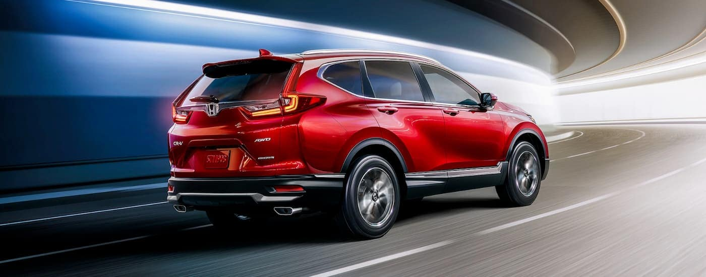 A red 2020 Honda CR-V Touring is driving through a tunnel near Rochester, NY.