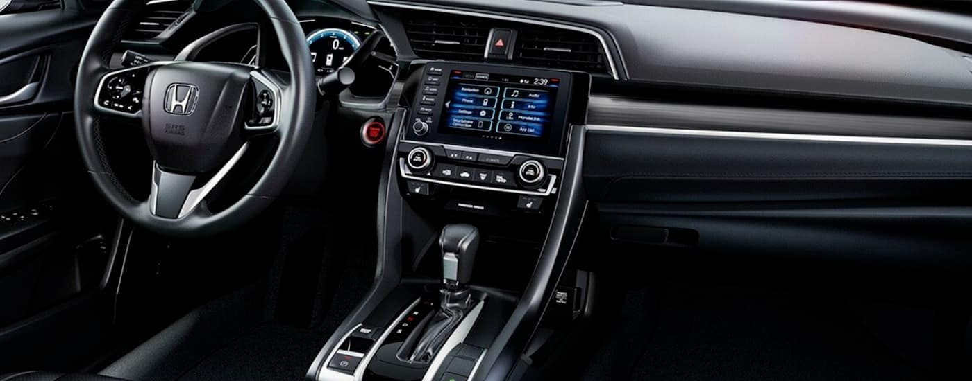 The black interior of a 2020 Honda Civic Sedan is shown.