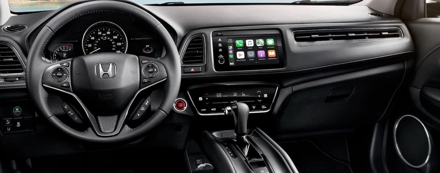 The dashboard of a 2020 Honda HR-V Touring is shown in black.