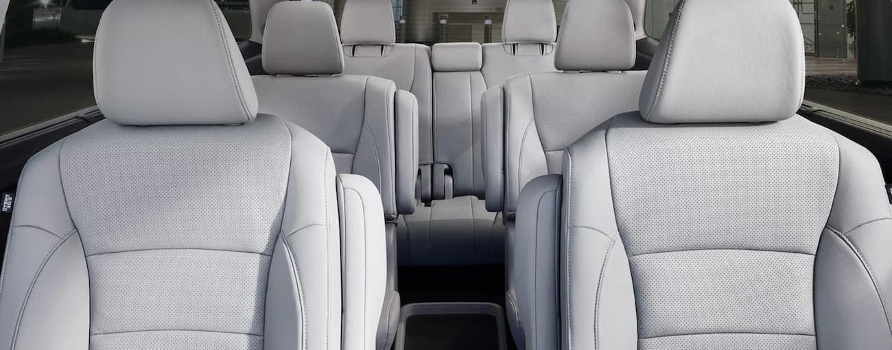 The white interior of a 2020 Honda Pilot Elite is shown.