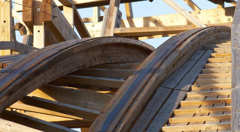 A closeup is shown of a wooden rollercoaster in Rochester, NY.