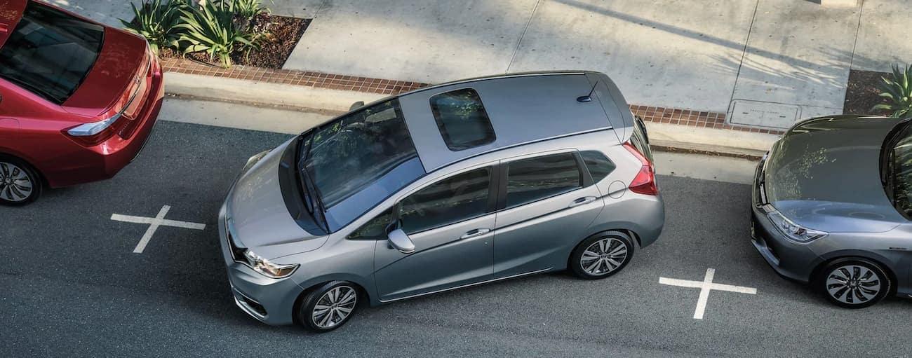 A grey 2020 Honda Fit EX-L is parallel parking.