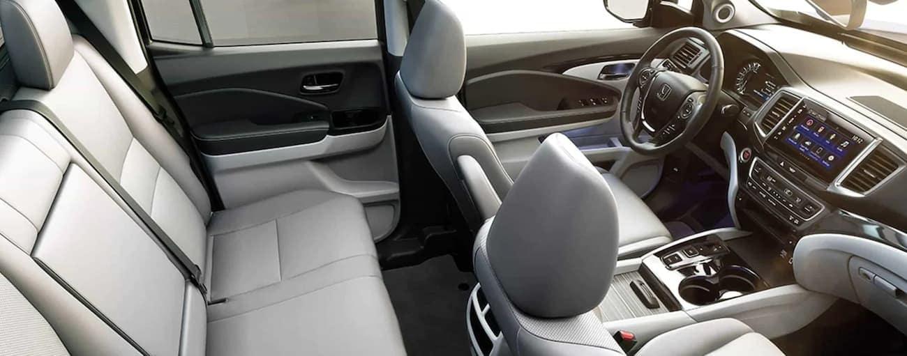 The white interior of a 2020 Honda Ridgeline RTL-E is shown.