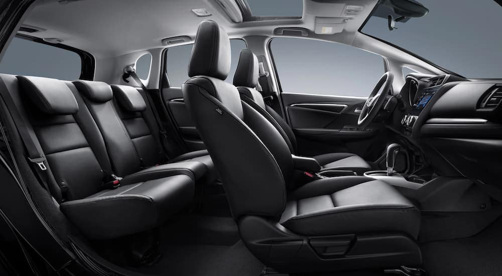 The black interior in a 2020 Honda Fit EX-L is shown from the side.