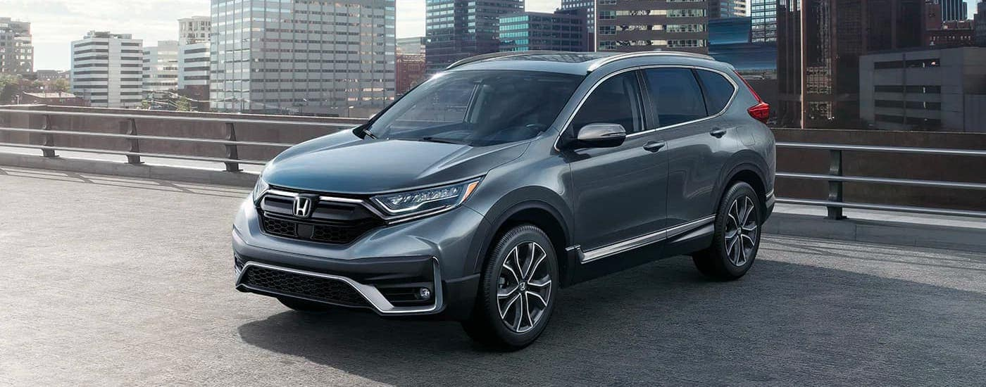 A gray 2020 Honda CR-V Touring is parked atop a parking garage near Rochester, NY.