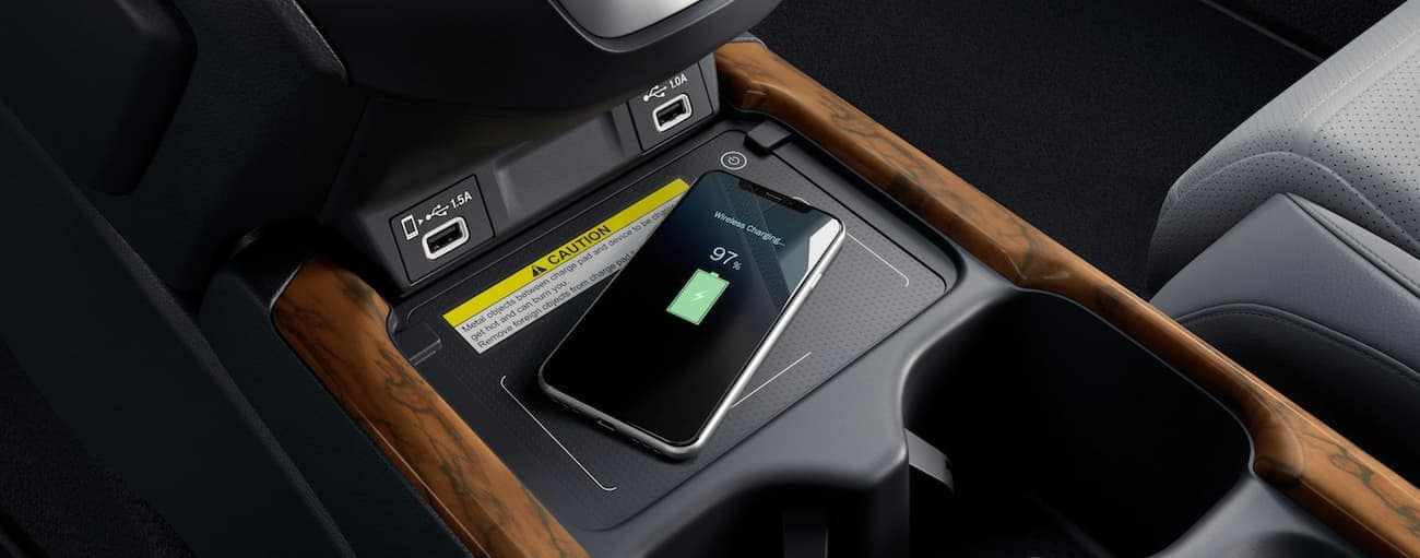 A phone is wirelessly charging on the center console of a 2020 Honda CR-V Touring.