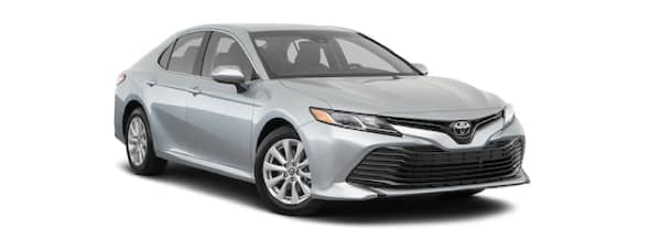 A silver 2020 Toyota Camry is facing right.