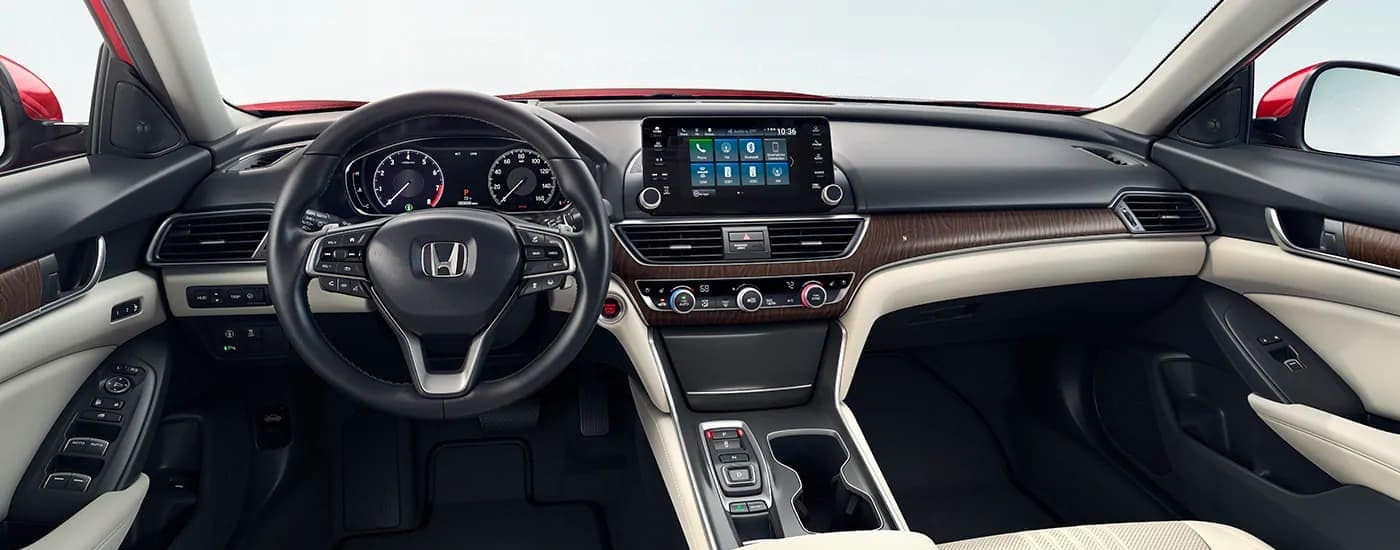 The interior dashboard and steering wheel are shown inside a 2020 Honda Accord near Rochester, NY.
