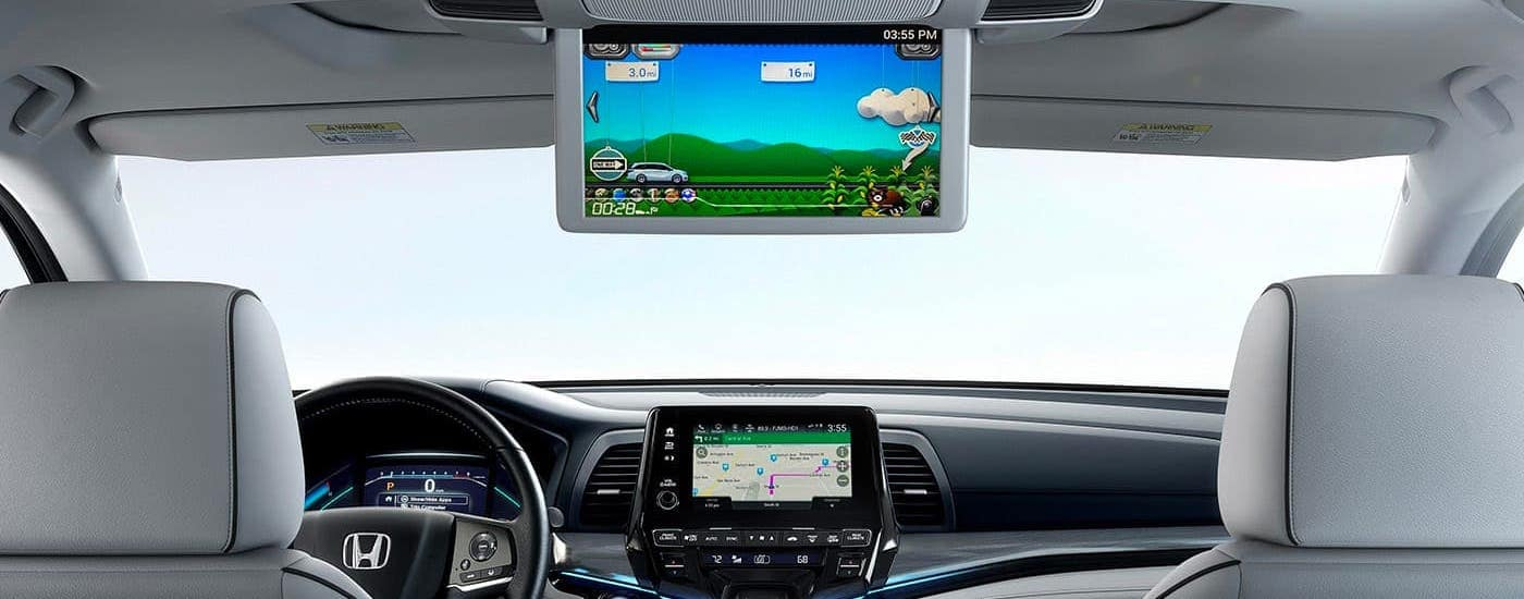 The rear screen is shown in the back of a 2020 Honda Odyssey, the winner of the 2020 Honda Odyssey vs 2020 Toyota Sienna comparison.
