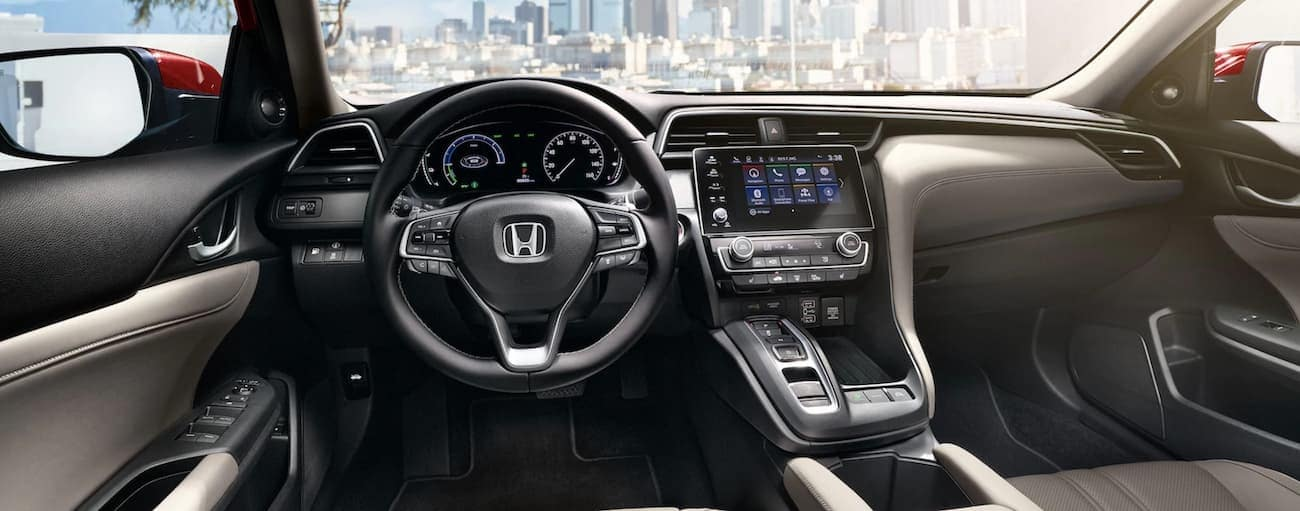 The dashboard and infotainment screen in a 2021 Honda Insight Touring are shown.