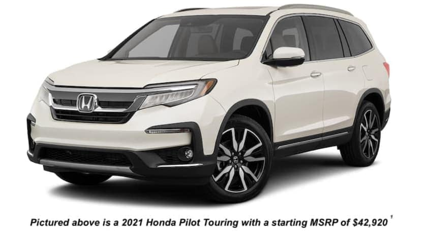 A white 2021 Honda Pilot is angled left.