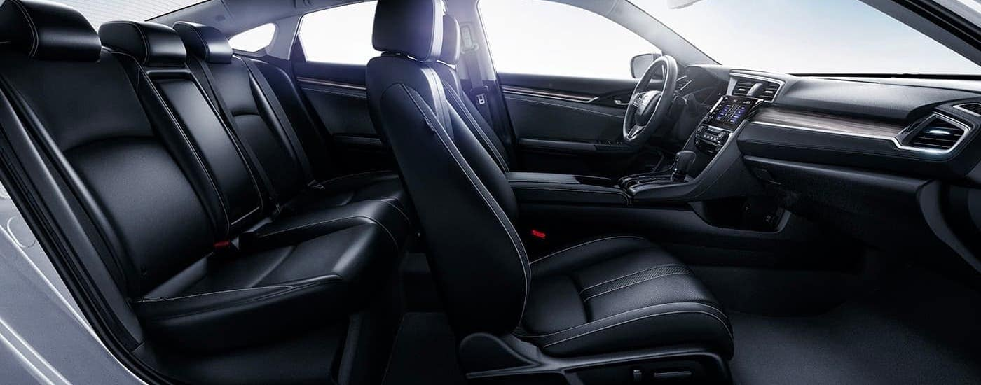 The black leather seats in a 2021 Honda Civic Touring are shown from the side.