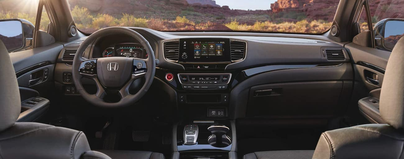 The dashboard of a 2021 Honda Passport Elite is shown.