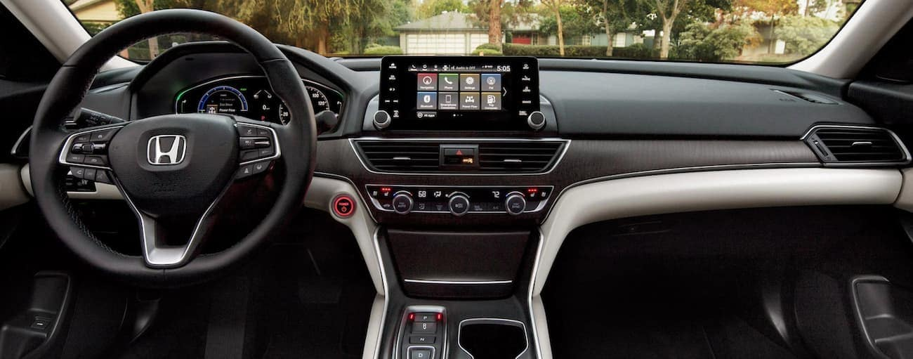 The dashboard and infotainment screen in a 2021 Honda Accord Hybrid Touring are shown.