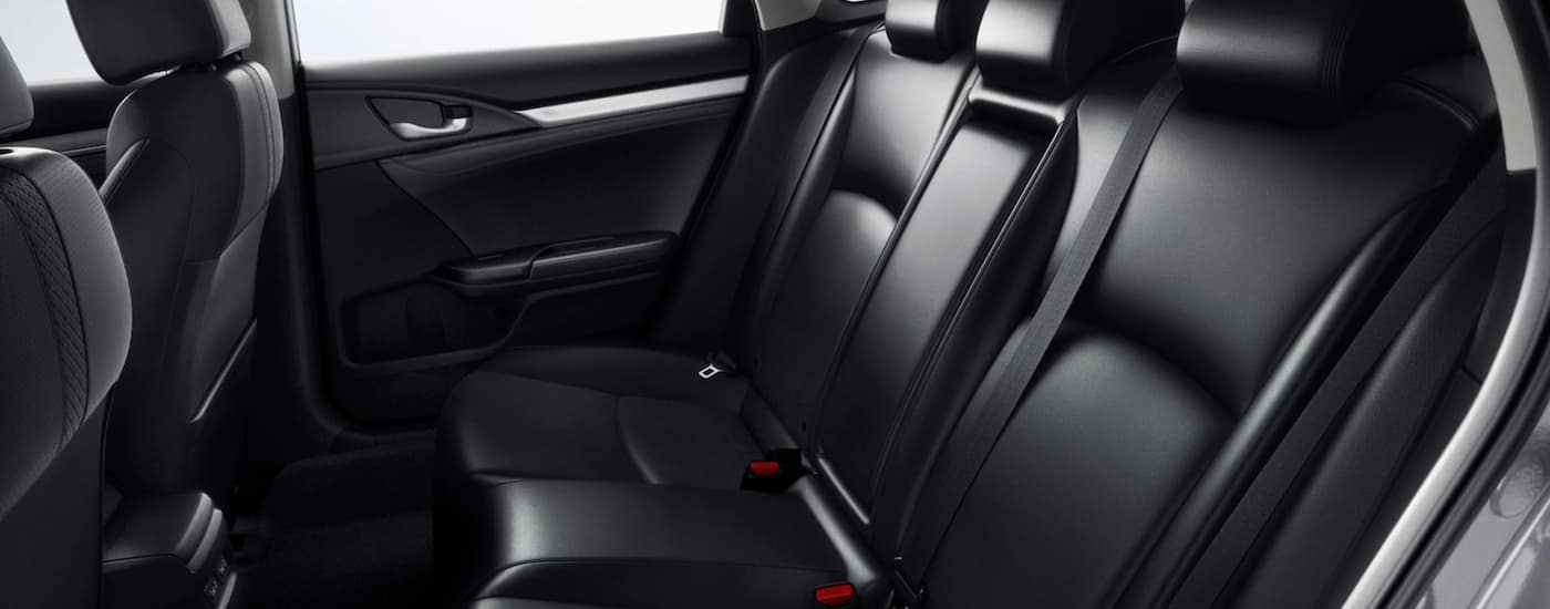 A close up shows the rear black leather seats in a 2021 Honda Civic Touring.