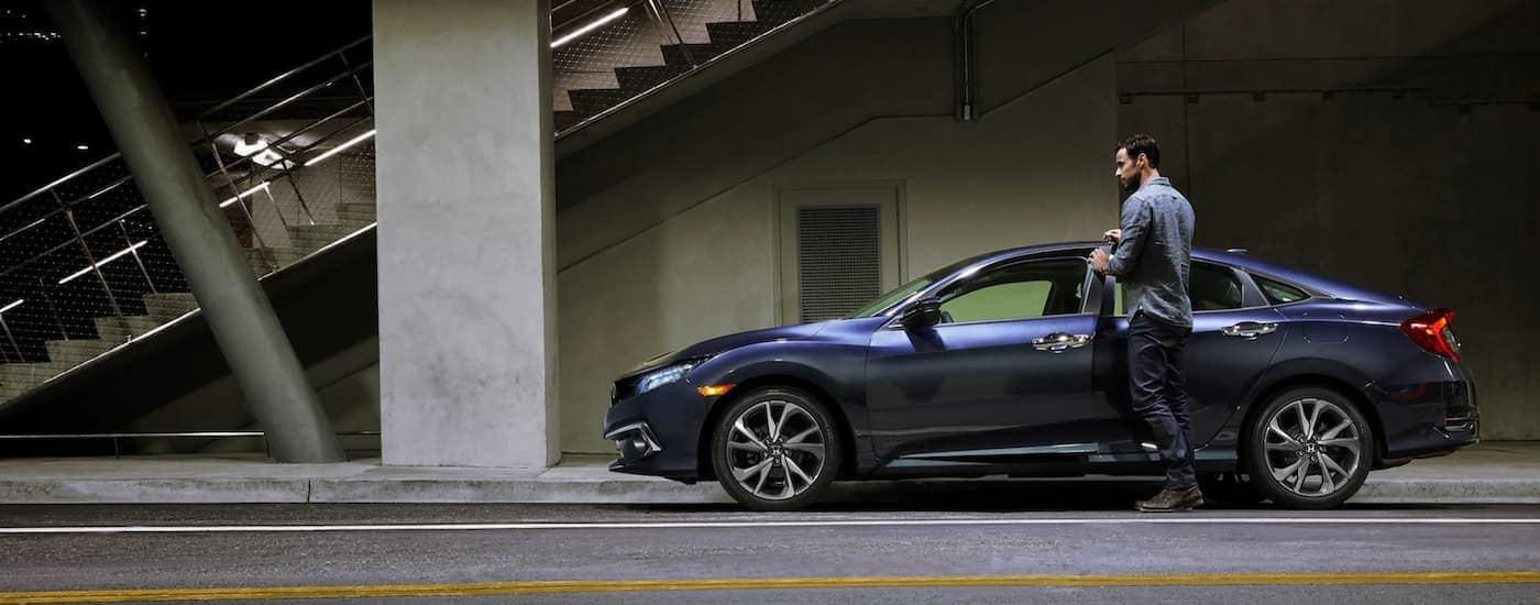 A blue 2021 Honda Civic Sport is shown from the side after winning the 2021 Honda Civic vs 2021 Nissan Sentra matchup.