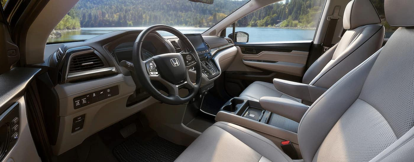 The tan and black interior is shown from the driver's side in a 2022 Honda Odyssey.