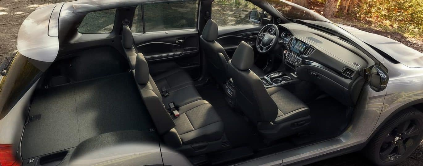 A cutaway view is shown of the interior in a 2021 Honda Passport Elite.