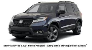 A dark blue 2021 Honda Passport Touring is angled left.