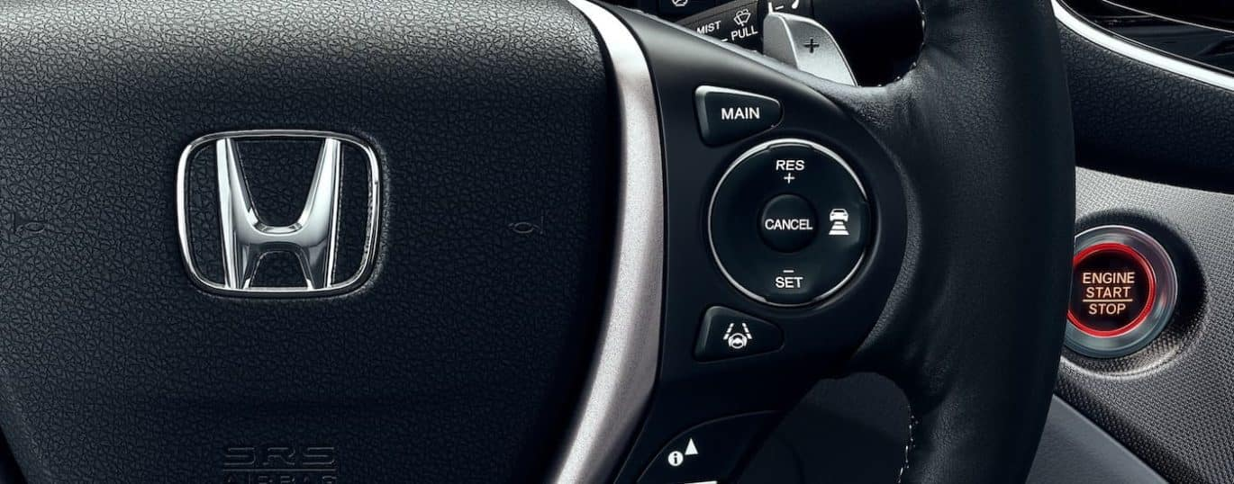 A close up shows the steering wheel controls in a 2021 Honda Ridgeline RTL-E.