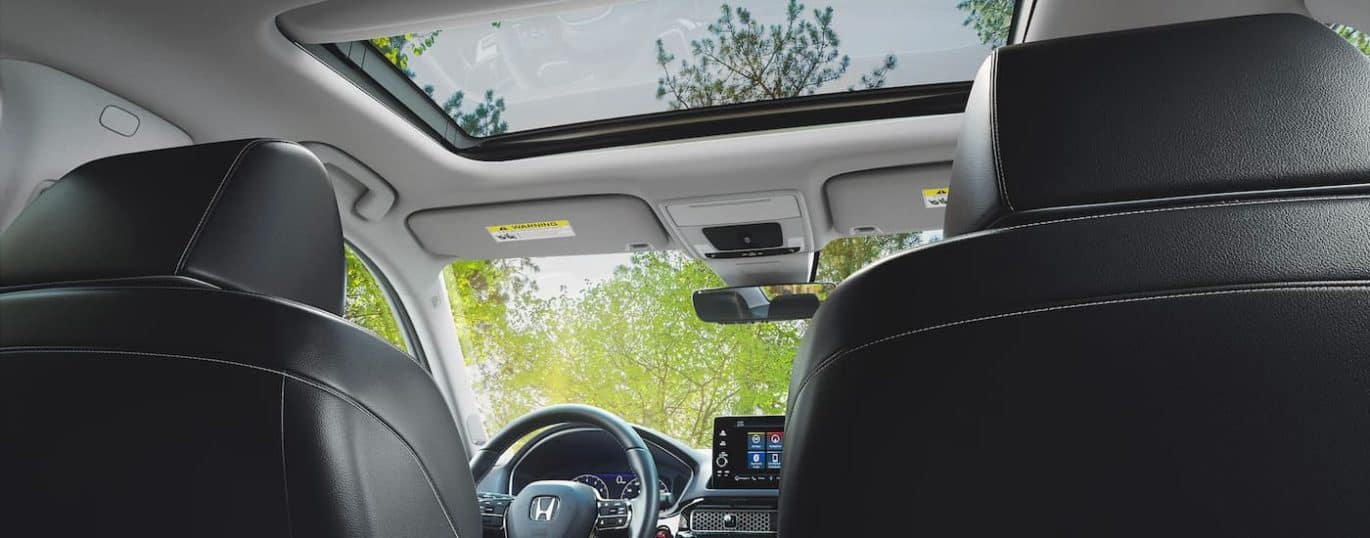 The moonroof is shown from a low angle in a 2022 Honda Civic Touring.