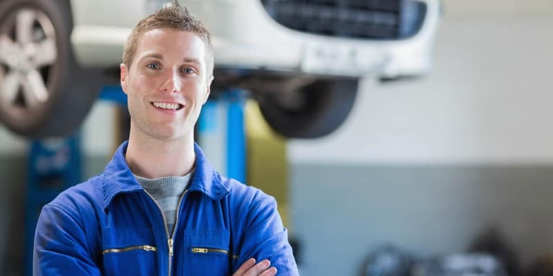 young mechanic smiling