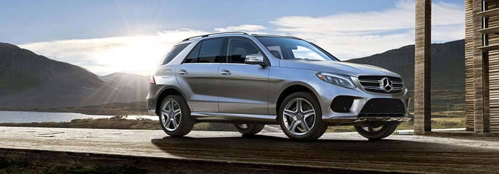 2018 Mercedes-Benz GLE parked outside a house by a lake