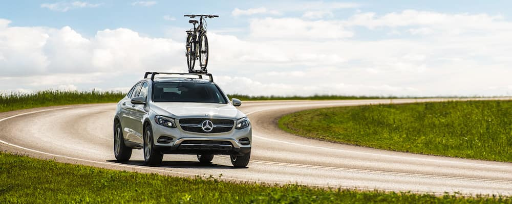 Silver Mercedes-Benz crossover SUV with bike mounted on roof