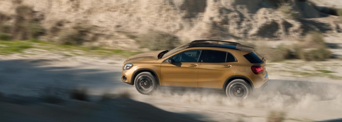 Gold Mercedes-Benz SUV on Dirt Road