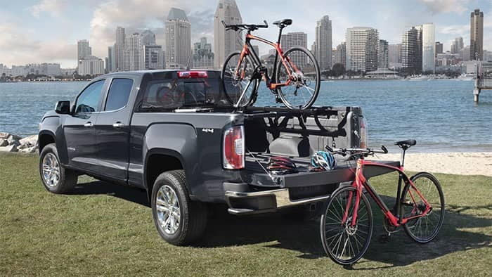 2019 GMC Canyon with Bikes Loaded on Racks in Bed of Truck