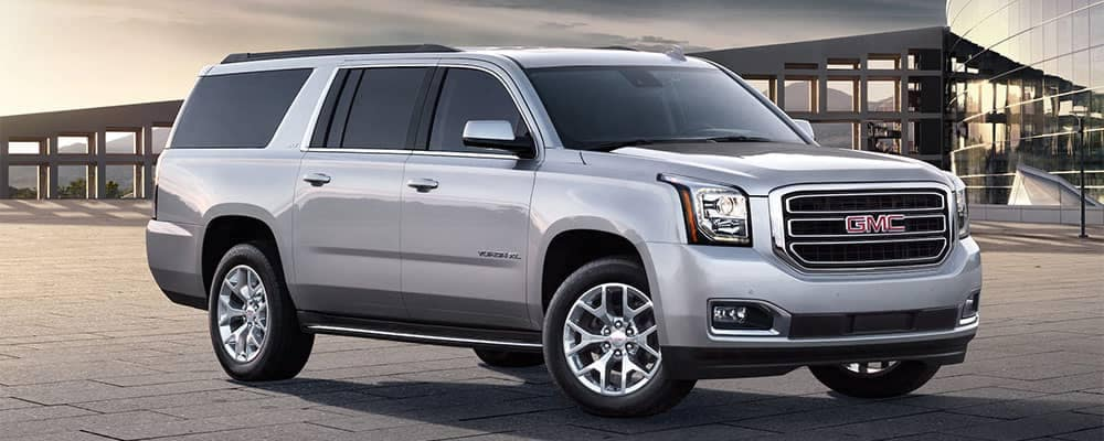 2019 GMC Yukon Parked In Front of Building