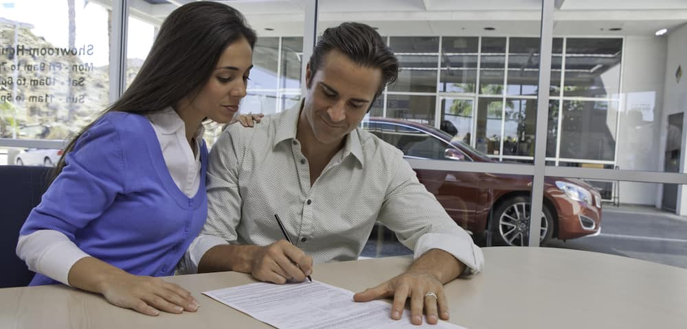 couple signing paperwork