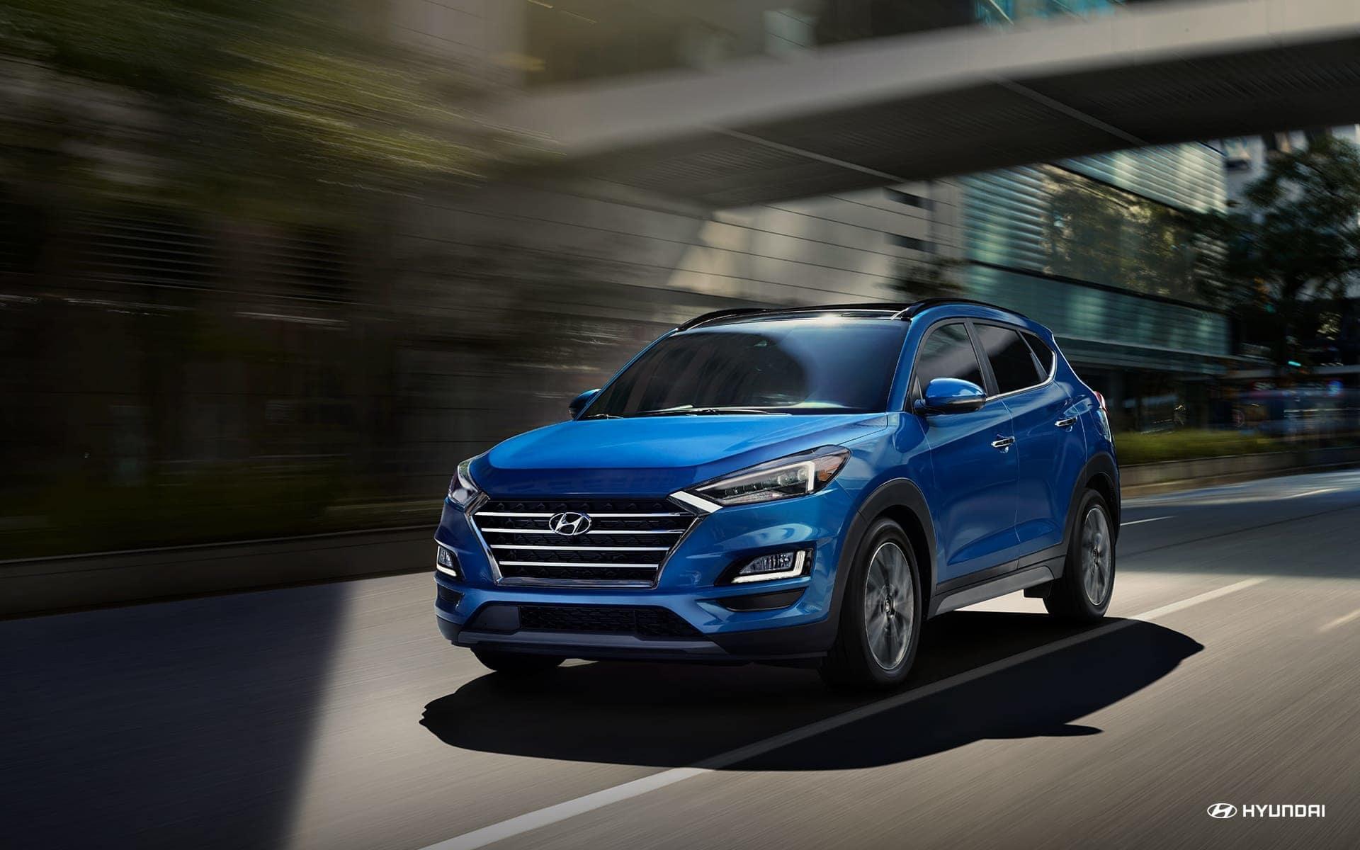 2019-Hyundai-Tucson-driving-down-road