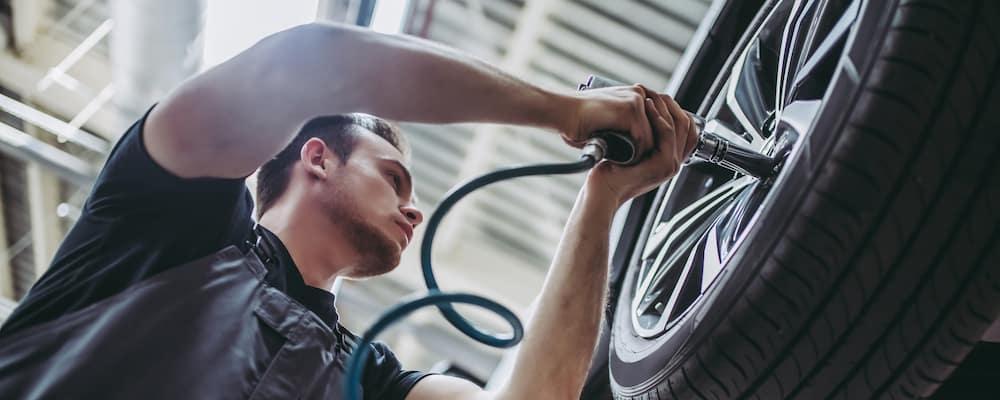 mechanic rotating tires