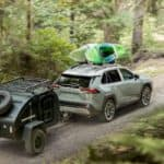2019 toyota rav4 with kayak rack and towing camper through woods