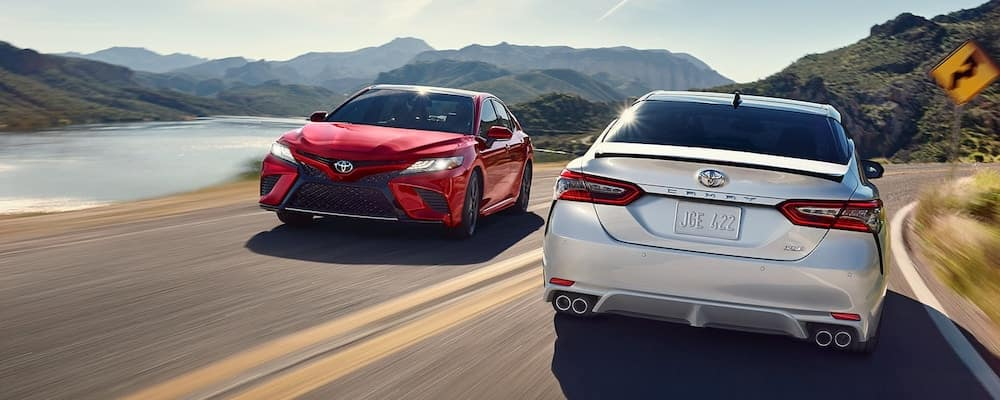 red and silver 2019 toyota models on road