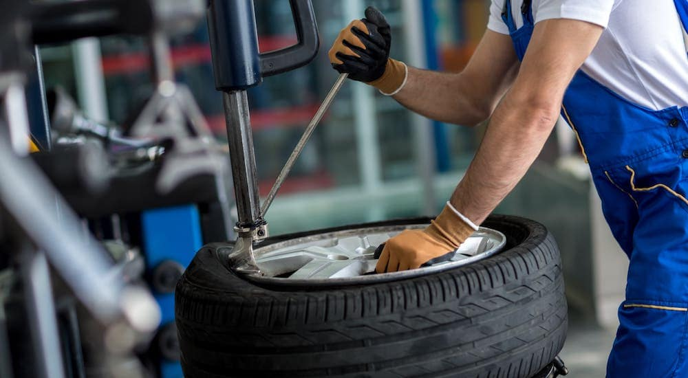 A mechanic is changing a tire at a tire shop near you.