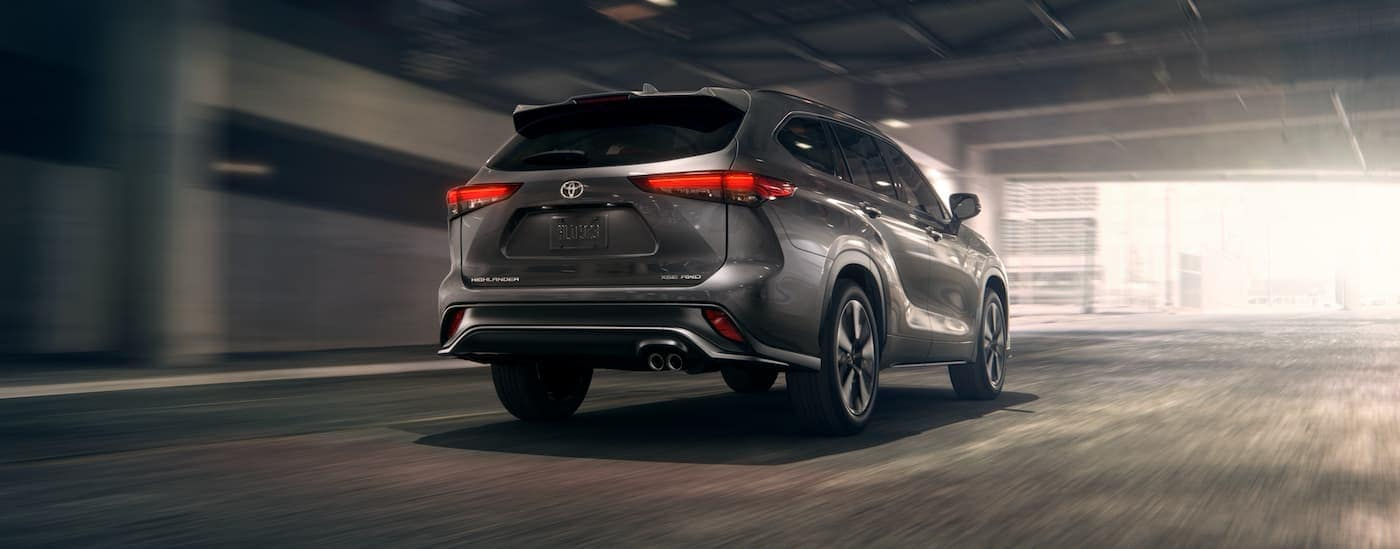 A grey 2021 Toyota Highlander is driving through a city tunnel.