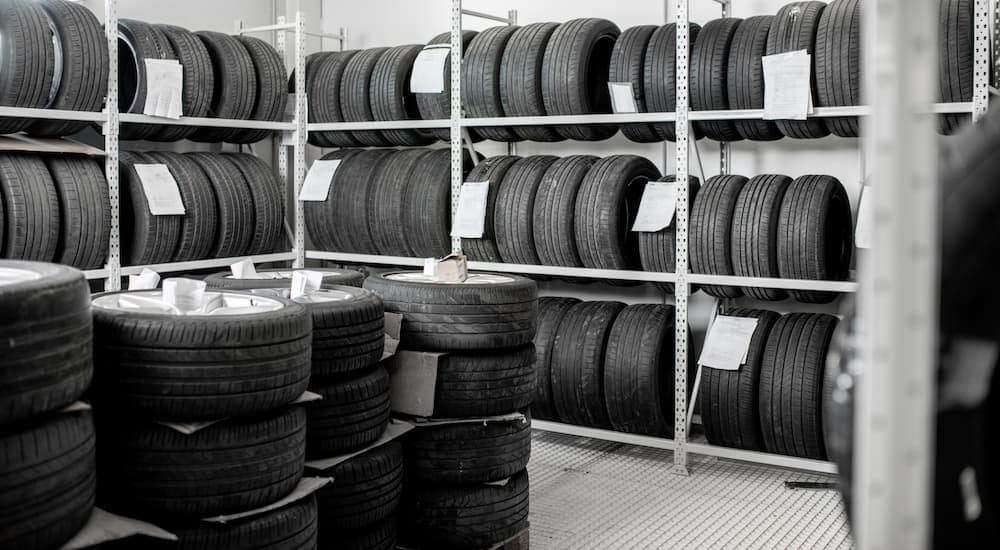 A black and white photo is showing racks full of tires.