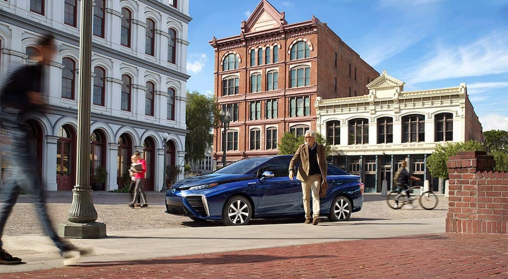 A blue 2021 Toyota Mirai is parked in the city after leaving a Toyota dealer near you.