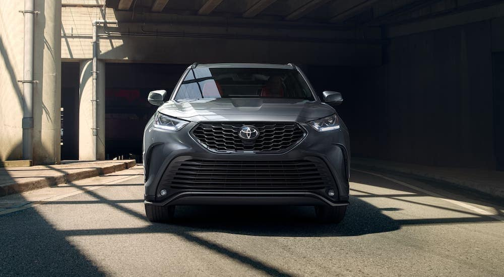 A gray 2021 Toyota Highlander is shown from the front while under a bridge.