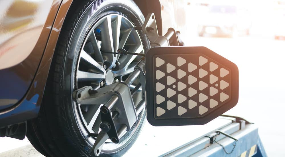 A close up is shown of the alignment target mounted to a wheel.