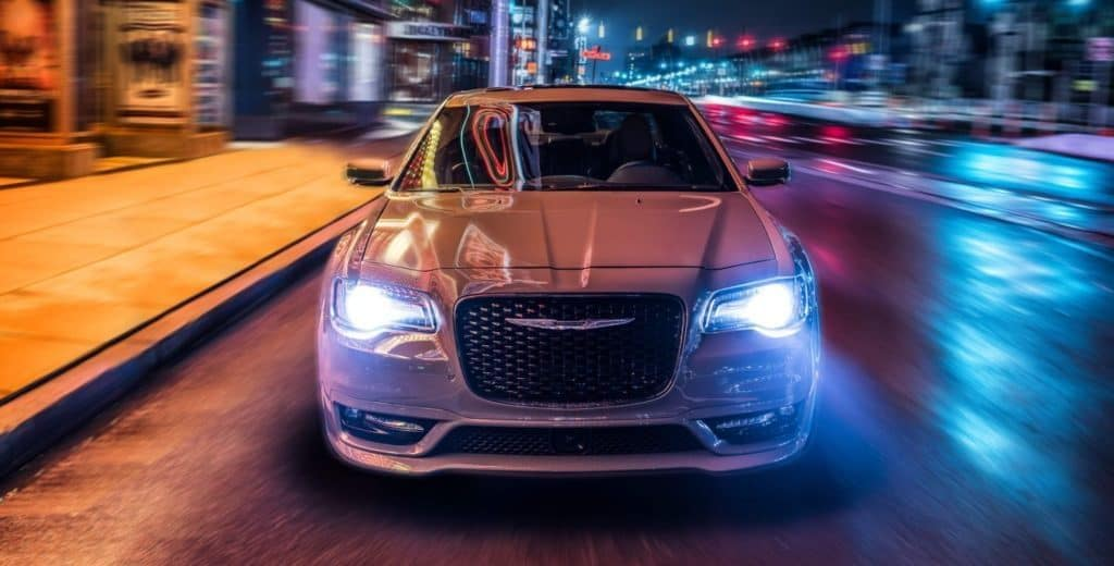 Chrysler 300 at night on city streets