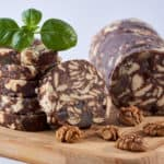Chocolate salami with walnuts and biscuits against white background