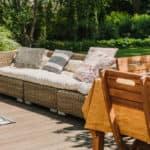 Cute sunny terrace in the green garden of trendy estate