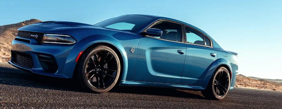 Blue Charger SRT Hellcat Widebody on a desert highway
