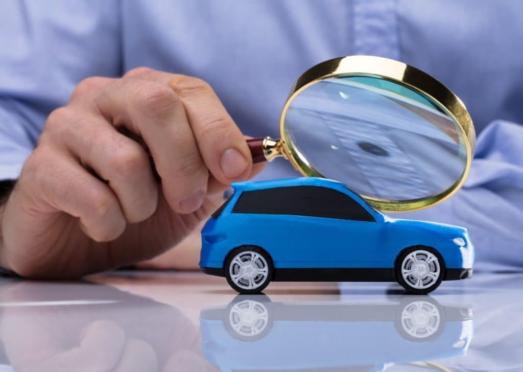 toy car under magnifying glass