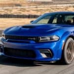 blue Dodge Charger on a desert road